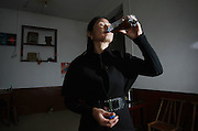 XIANGTAN, CHINA - OCTOBER 29: (CHINA OUT)<br /> <br /> Drinking Faeces Of Cow And Sheep To Treat Cancer<br /> <br />  A woman of Jinshi village drinks water of faeces from cows and sheep on October 29, 2014 in Xiangtan, Hunan province of China. Over 20 families in Jinshi village prevent and treat disease by drinking water of faeces from cows and sheep because a local elder woman said that faeces of cow and sheep through drying, toasting, grinding and then giving water to drink can prevent and treat disease and her cancer got better after drinking for eight months. <br /> ©Exclusivepix