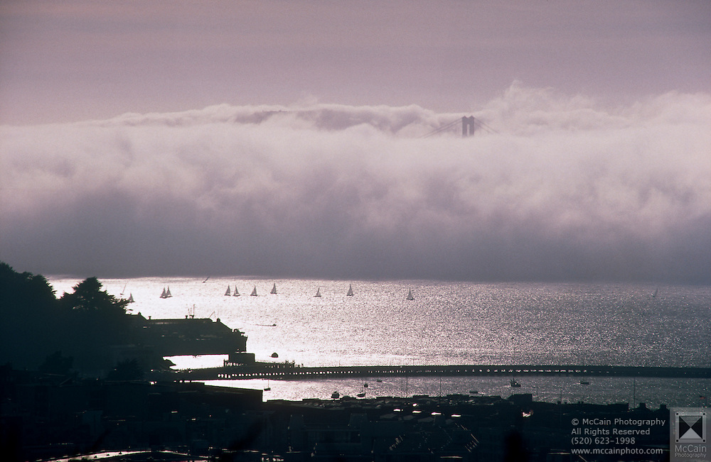 Distant view of sailboats in the bay with the top of Golden Gate Bridge peeking through the late afternoon fog, San Francisco, California...Media Usage:.Subject photograph(s) are copyrighted Edward McCain. All rights are reserved except those specifically granted by McCain Photography in writing...McCain Photography.211 S 4th Avenue.Tucson, AZ 85701-2103.(520) 623-1998.mobile: (520) 990-0999.fax: (520) 623-1190.http://www.mccainphoto.com.edward@mccainphoto.com