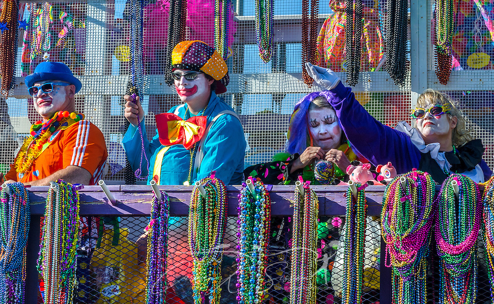 A member of the Clown A Rounds throws beads to the crowd as his float travels down Canal Street in downtown Mobile, Ala., during the Joe Cain Procession at Mardi Gras, March 2, 2014. French settlers held the first Mardi Gras in 1703, making Mobile's celebration the oldest Mardi Gras in the United States. (Photo by Carmen K. Sisson/Cloudybright)