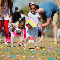 Thomas Wells | BUY at PHOTOS.DJOURNAL.COM<br /> Shyla Robinson, 4, hurries to get eggs in her basket as the Easter Egg hunt at Ballard Park gets started on Saturday.