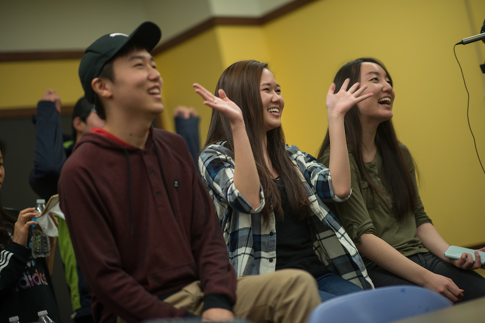 Abraham Kim, left, and Diane Seo, center, sing along to a Kpop song at Korean Culture Night in Harris Hall, Feb. 12, 2016 at Northwestern University in Evanston. (Photography by Rob Hart)