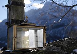 THEMENBILD - Winter Wanderung von Lienz zum Reiter Kirchl welches sich ueber Leisach auf 1130 m Seehoehe befindet, das Bild wurde am 25. Dezember 2011 aufgebommen, im Bild Laterne unter einem Kreuz, AUT, EXPA Pictures © 2011, PhotoCredit: EXPA/ M. Gruber