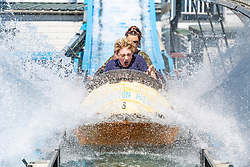 © Licensed to London News Pictures. 03/06/2018. Brighton, UK. Members of the public take a ride on the Brightons Palace Pier Wild River water attraction as thousands of visitors take to the beach in Brighton and Hove as hot and sunny weather his hitting the seaside resort. Photo credit: Hugo Michiels/LNP