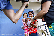 023 Jane De La Cruz, female, 1 years old, before UCL, is photographed during screening.<br /> Isabel United Doctor Medical Centre. Operation Smile's 2015 mission to Cauayan city. Philippines. 14th -21st February 2015.<br /> <br /> (Operation Smile Photo - Zute Lightfoot)