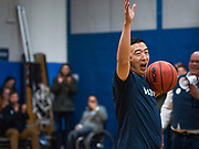 12 DECEMBER 2019 - DES MOINES, IOWA: ANDREW YANG with the ball during a basketball game with J.D. Scholten in the gym in the Ames, IA, City Hall. Scholten is an Iowa Democrat running against Republican Congressman Steve King. Yang, an entrepreneur, is running for the Democratic nomination for the US Presidency in 2020. He brought bus tour to Ames, IA, Thursday. Iowa hosts the the first election event of the presidential election cycle. The Iowa Caucuses will be on Feb. 3, 2020.        PHOTO BY JACK KURTZ
