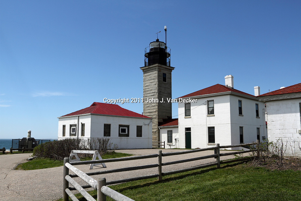 Beavertail Lighthouse on a clear day. Jamestown, Rhode Island, USA. Beavertail Lighthouse sits on the western shore and marks the entrance to Narragansett Bay.