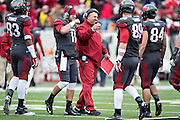 LITTLE ROCK, ARKANSAS - NOVEMBER 23:  Head Coach Bret Bielema of the Arkansas Razorbacks congratulates his players as they come off the field during a game against the Mississippi State Bulldogs at War Memorial Stadium on November 23, 2013 in Little Rock, Arkansas.  The Bulldogs defeated the Razorbacks 24-17.  (Photo by Wesley Hitt/Getty Images) *** Local Caption *** Bret Bielema