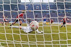 26.02.2011, Veltins Arena, Gelsenkirchen, GER, 1.FBL, FC Schalke 04 vs 1. FC Nuernberg, im Bild das 0:1 Tor von Robert Mak (1. FC Nürnberg SLO #14), der als zweiter v. r. auf dem Platz hinten ist. Rechts jubelt Andreas Wolf (1. FC Nürnberg GER #5), links kommt Jens Hegeler (1. FC Nürnberg GER #13) und Torwart Manuel Neuer (Schalke GER #1) ist vom Ball verdeckt, aufgenommen mit Hintertor-Kamera, EXPA Pictures © 2011, PhotoCredit: EXPA/ nph/  Scholz       ****** out of GER / SWE / CRO  / BEL ******