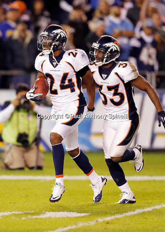 Denver Broncos cornerback Champ Bailey (24) celebrates after intercepting a pass during the NFL week 11 football game against the San Diego Chargers on Monday, November 22, 2010 in San Diego, California. The Chargers won the game 35-14. (©Paul Anthony Spinelli)
