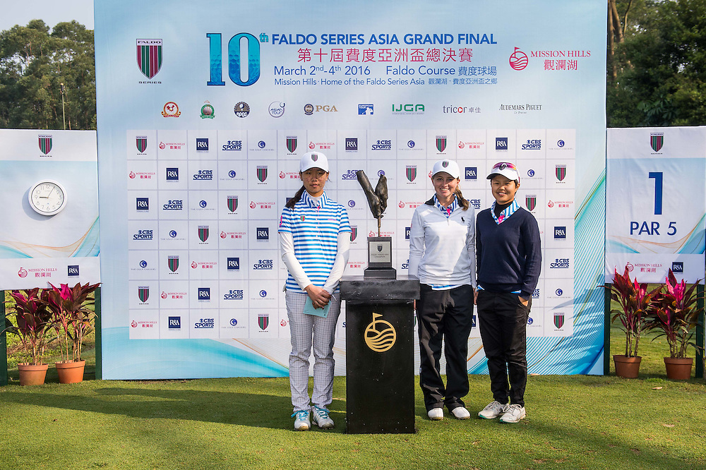 Kaitlyn Papp of United States of America, Siyu Wang of China and Jacqueline Young of Singapore pose for a picture with the trophy during day one of the 10th Faldo Series Asia Grand Final at Faldo course in Shenzhen, China. Photo by Xaume Olleros.