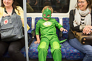 UNITED KINGDOM, London: 26 May 2019 <br /> Cosplayer Stanley Gaydon, aged 5, dressed as Gekko from cartoon PJ Masks, makes his way to London ExCeL for the final day of the MCM London Comic Con. The three day comic convention is being held at London ExCeL from Fri 24th - Sun 26th of May.