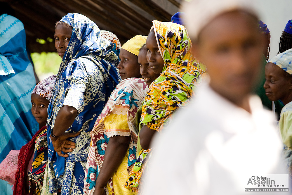 Refugees from Central African Republic wait for food distribution at the Garga Sarali integrated health center in the town of Garga Sarali, near Bertoua, Cameroon, on Tuesday September 15, 2009.