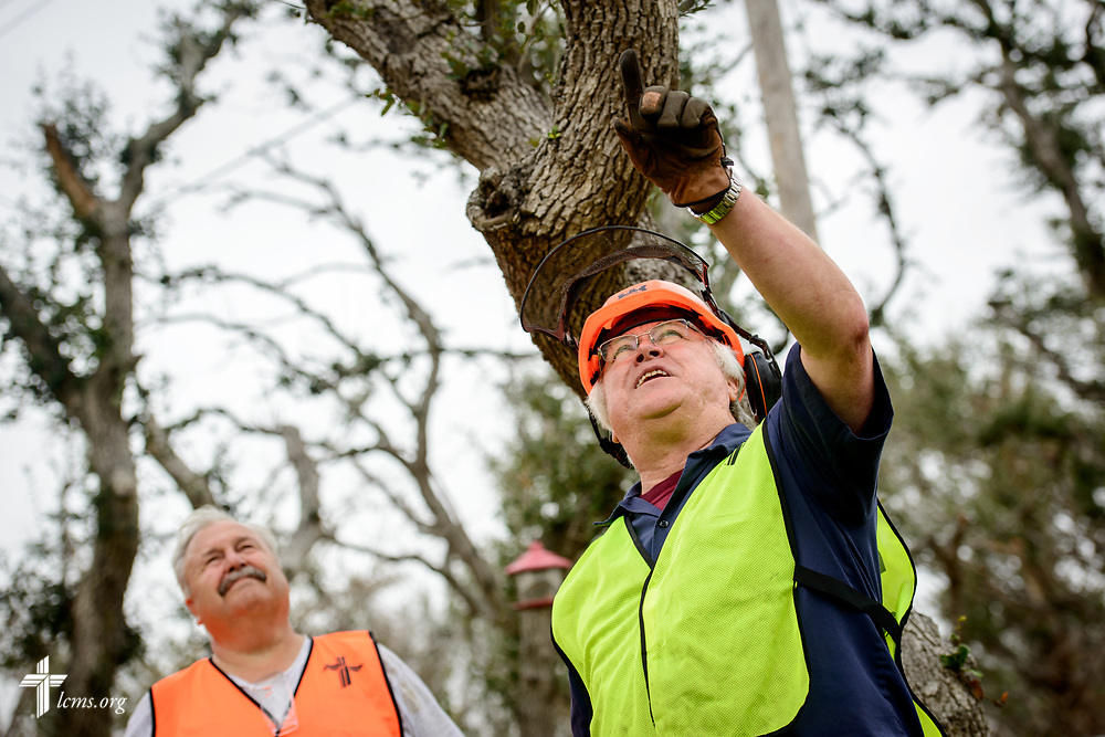 The Rev. Ed Brashier, Southern District Disaster Response Coordinator, assesses a damaged tree with the Rev. David Winters, a retired pastor and volunteer from Parkers Prairie, Minn., on Tuesday, Feb. 6, 2018, at a home in Rockport, Texas. LCMS Communications/Erik M. Lunsford
