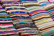Stacks of fabrics for sale in Ben Thanh Market. Ben Thanh Market is a large market located in downtown Ho Chi Minh City (Saigon), Vietnam.