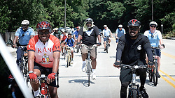 In the foreground, on the right, Anthony Murphy, Executive Director of Town Watch Integrated Services (right) is seen riding his bike among the participating cyclist of the Bike for Peace ride. (Bastiaan Slabbers/for NewsWorks)