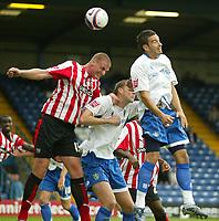 Photo: Aidan Ellis.<br /> Bury FC v Brentford. Coca Cola League 2. 01/09/2007.<br /> Bury's Paul Scott beats Brentford's Matthew Heywood to the header
