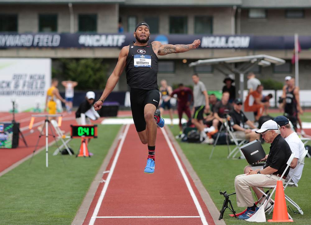 Georgia's Devon Williams takes off in the long jump during the men's decathlon on the first day of the NCAA college track and field championships in Eugene, Ore. on Wednesday, June 7, 2016 (AP Photo/Timothy J. Gonzalez)