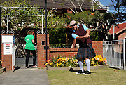 A golfer hits a shot on World Urban Golf Day in Newcastle, Australia. Played with soft balls and without keeping score, Urban Golf is an attempt to take the game of golf away from the manicured lawns and into the urban environment.