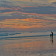 A father and daughter share a moment during sunset in Domincal, Costa Rica.  Photo by William Byrne Drumm.