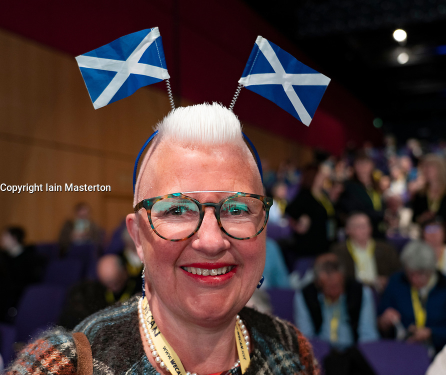 Edinburgh, Scotland, UK. 27 April, 2019. SNP ( Scottish National Party) Spring Conference takes place at the EICC ( Edinburgh International Conference Centre) in Edinburgh. Pictured Agnes Magowan a delegate at the conference with patriotic headwear.
