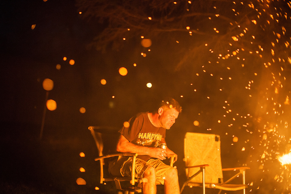 Steve McFarland watches a bonfire burn in his back yard on Sunday, March 25, 2012 in Webster City, IA.