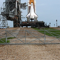 Shuttle Atlantis rests atop the launch pad at Kennedy Space Center Thursday, July 7, 2011, in Cape Canaveral, Fla. Shuttle Atlantis is scheduled to launch on Friday, July 8 and is the 135th and final space shuttle launch for NASA..  (AP Photo/Alex Menendez)