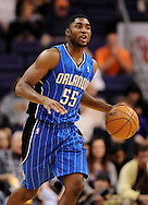 Dec. 09, 2012; Phoenix, AZ, USA; Orlando Magic guard E'Twaun Moore (55) handles the ball during the game against the Phoenix Suns in the second half at US Airways Center. The Magic defeated the Suns 98-90. Mandatory Credit: Jennifer Stewart-USA TODAY Sports.