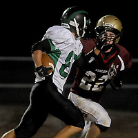 Ashley High School's Parker Greenough attempts to tackle West Brunswick's Tristan Lewis Friday November 7, 2014. (Jason A. Frizzelle)
