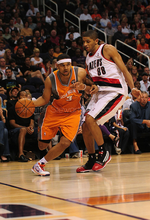 Mar. 21 2010; Phoenix, AZ, USA; Phoenix Suns forward Jared Dudley (3) drives the ball against Portland Trailblazers forward Nicolas Batum (88)  in the second half at the US Airways Center. The Suns defeated the Trail Blazers 93 to 87. Mandatory Credit: Jennifer Stewart-US PRESSWIRE.