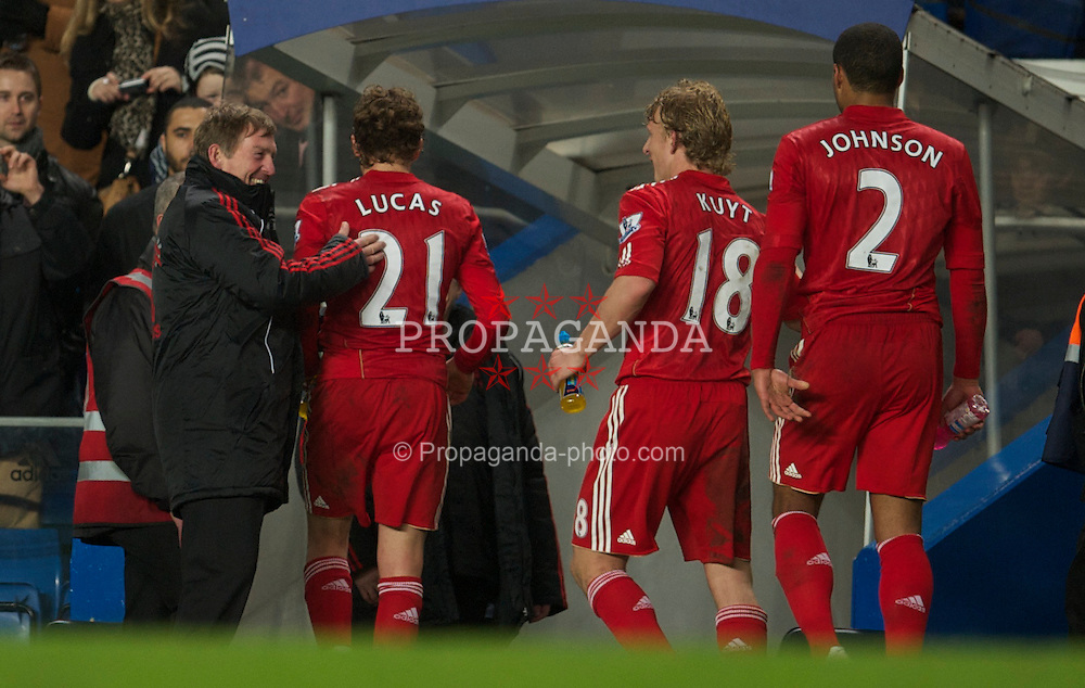LONDON, ENGLAND - Sunday, February 6, 2011: Liverpool's manager Kenny Dalglish celebrates with Lucas Leiva after his side's 1-0 victory over Chelsea during the Premiership match at Stamford Bridge. (Photo by David Rawcliffe/Propaganda)