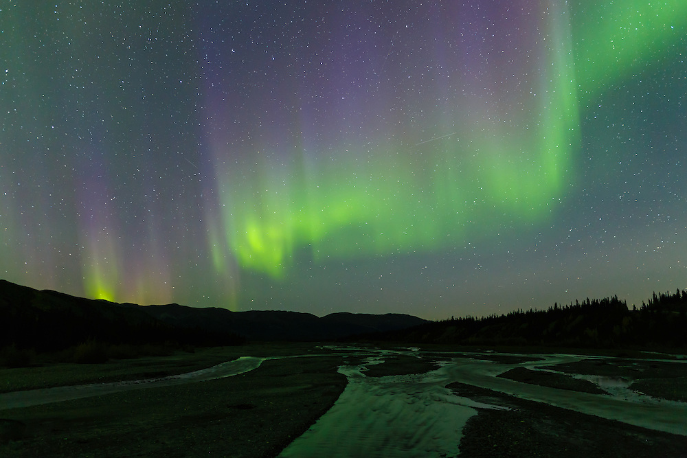 Aurora above Teklanika River in Denali National Park in Interior Alaska. Autumn. Evening.