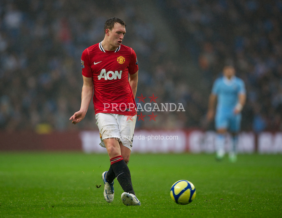 MANCHESTER, ENGLAND - Sunday, January 8, 2012: Manchester United's Phil Jones in action against Manchester City during the FA Cup 3rd Round match at the City of Manchester Stadium. (Pic by David Rawcliffe/Propaganda)