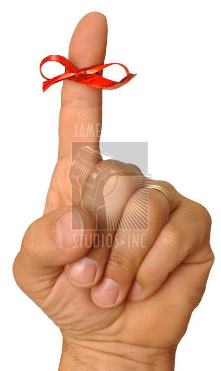 Ribbon tied to finger on white
