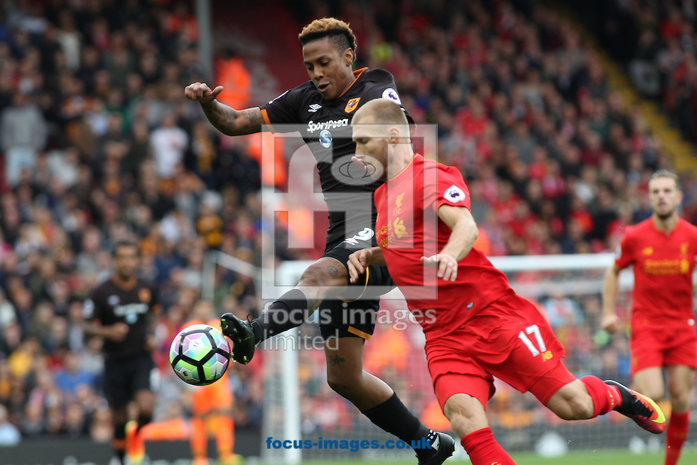 Abel Hernandez of Hull City and Ragnar Klavan of Liverpool in action during the Premier League match at Anfield, Liverpool.<br /> Picture by Michael Sedgwick/Focus Images Ltd +44 7900 363072<br /> 24/09/2016