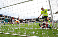 Bobby Zamora of Brighton and Hove Albion (right) scores his team's 1st goal to make it 1-0 as Tendayi Darikwa of Burnley (floor) is unable to stop the ball crossing the line during the Sky Bet Championship match at Turf Moor, Burnley<br /> Picture by Russell Hart/Focus Images Ltd 07791 688 420<br /> 22/11/2015