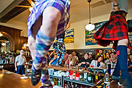 Caledonian Pipe Band dances on the bar at Glenns Food and Spirits in Livingston Montana at 4th of July celebration