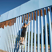 "Artist Ana Teresa Fernández with local and some Arizonians paint the fence in blue color the theme called ""Erasing the Border"" in Nogales Sonora, Mexico on October 13, 2015."