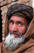Portrait of old man with war-weary eyes, turban and beard in Kabul, Afghanistan. 2002