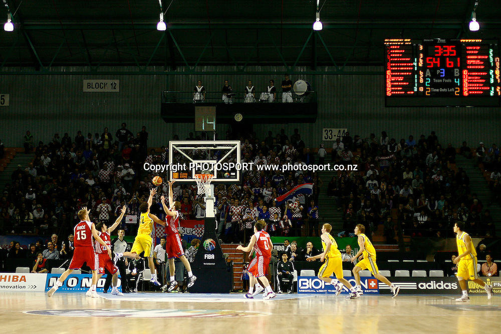 Australia's Cody Ellis goes to the basket in front of the Croatian Supporters. U19 Basketball World Championship, 3rd and 4th place game, Australia v Croatia, North Shore Events Centre, Auckland. 12 July 2009. Photo: Anthony Au-Yeung/PHOTOSPORT