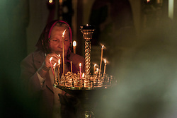 April 27, 2019 - Naroulia, Gomel, Belarus - A woman puts a candle in the church of Naroulia, during the celebrations of the Easter in Belarus. (Credit Image: © Celestino Arce Lavin/ZUMA Wire)