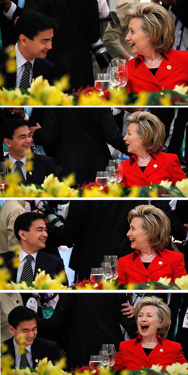 epa01932832 Combination photo showing U.S. Secretary of State Hillary Clinton (R) and Thailand's Prime Minister Abhisit Vejjajiva (L) sharing a laugh in conversation at the luncheon start of the summit of leaders of 21 Pacific Rim nations as they sit down together  at the Asia-Pacific Economic Cooperation (APEC) Economic Leaders summit held at the Istana or Presidential Palace, in Singapore, 14 November 2009.  EPA/HOW HWEE YOUNG