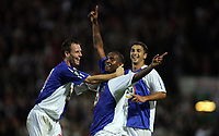 Photo: Paul Thomas.<br /> Blackburn Rovers v SV Red Bell. UEFA Cup. 28/09/2006.<br /> <br /> Blackburn goal scorer Benni McCarthy celebrates his goal with Andre Ooijer (L) and Zurab Khizanishvili (R).