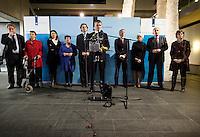 Nederland. Den Haag, 20 februari 2010.<br /> 05.12 uur, persconferentie Bos in ministerie van Financien, achtergrond, v.ln.l.r: minister van der Laan, staatssecretaris Klijnsma, staatssecretaris Albayrak, staatssecretaris Dijksma, minister Koenders, Bos, minister Plasterk, minister Cramer en fractievoorzitter Hamer.<br /> Premier Balkenende gaat het ontslag van zijn vierde kabinet indienen bij koningin Beatrix. Na een keiharde confrontatie in de ministerraad over de militaire missie in Uruzgan bleek rond vier uur 's nachts nog maar één conclusie mogelijk: aftreden.<br /> Foto Martijn Beekman