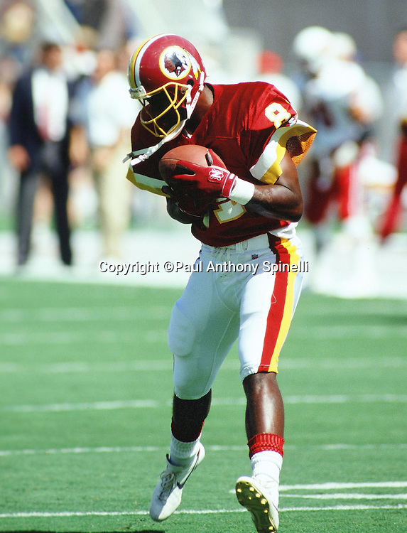 Washington Redskins wide receiver Art Monk (81) catches a pass during the NFL football game against the Arizona Cardinals on Oct. 4, 1992 in Tempe, Arizona. The Cardinals won the game 27-24. (©Paul Anthony Spinelli)
