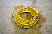 garden hose on wooden floor