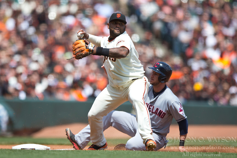 SAN FRANCISCO, CA - APRIL 26:  Pablo Sandoval #48 of the San Francisco Giants throws to first base to complete a double play after forcing out Yan Gomes #10 of the Cleveland Indians at third base during the fourth inning at AT&T Park on April 26, 2014 in San Francisco, California. The San Francisco Giants defeated the Cleveland Indians 5-3.  (Photo by Jason O. Watson/Getty Images) *** Local Caption *** Pablo Sandoval; Yan Gomes