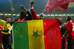CARDIFF, WALES - Sunday, March 2, 2003: Liverpool's Senegal stars Salif Diao (l) and El-Hadji Diouf celebrate with a Senegal flag after their 2-0 victory over Manchester United during the Football League Cup Final at the Millennium Stadium. (Pic by David Rawcliffe/Propaganda)