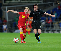 Jonathan Williams of Wales and James McCarthy of Republic of Ireland battle for the ball.  - Photo mandatory by-line: Alex James/JMP - Tel: Mobile: 07966 386802 14/08/2013 - SPORT - FOOTBALL - Cardiff City Stadium - Cardiff -  Wales V Republic of Ireland - International Friendly