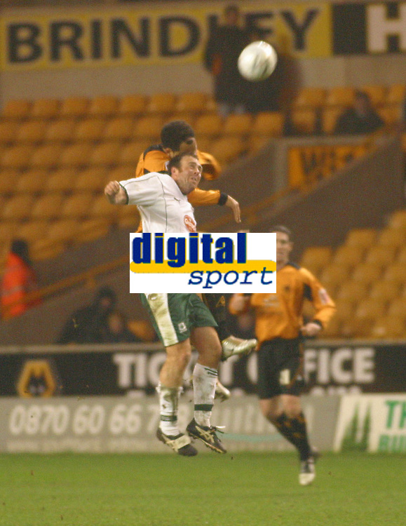 Photo: Dave Linney.<br />Wolverhampton Wanderers v Plymouth Argyle. The FA Cup.Plymouth's Mickey Evans(L) in an aerial battle with  Joleon Lescott<br />07/01/2006.