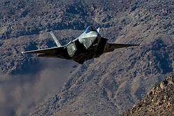 Lockheed Martin F-35A Lighting II from the 323 Squadron, Royal Netherlands Air Force, flies low level through the Jedi Transition, Star Wars Canyon, Death Valley National Park, California, United States of America